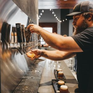 Premium craft beer being poured from the tap