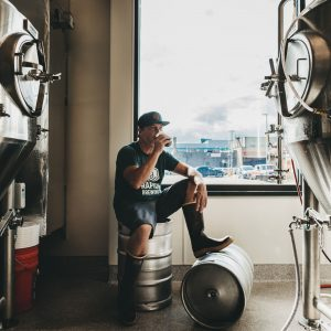 Head Brewer Darin Jensen drinking brown ale